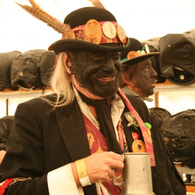 Mick Jarvis from Silurian Morris Men in the Dave Jones Bar drinking giggling lotion by Meg Hanlon