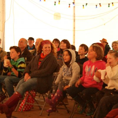 Audience enjoying Where's the Bear? show by Keith Donnelly in the ceilidh tent by Meg Hanlon